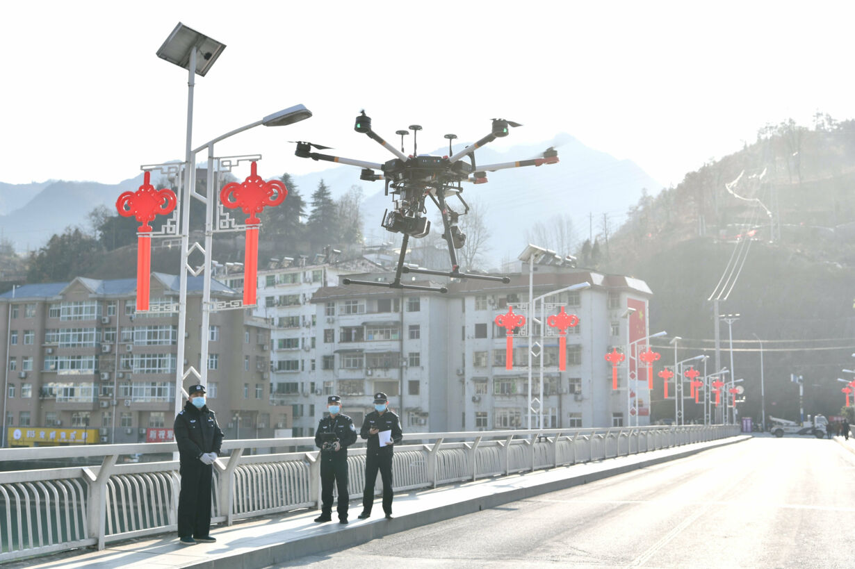 Police officers operate a dron