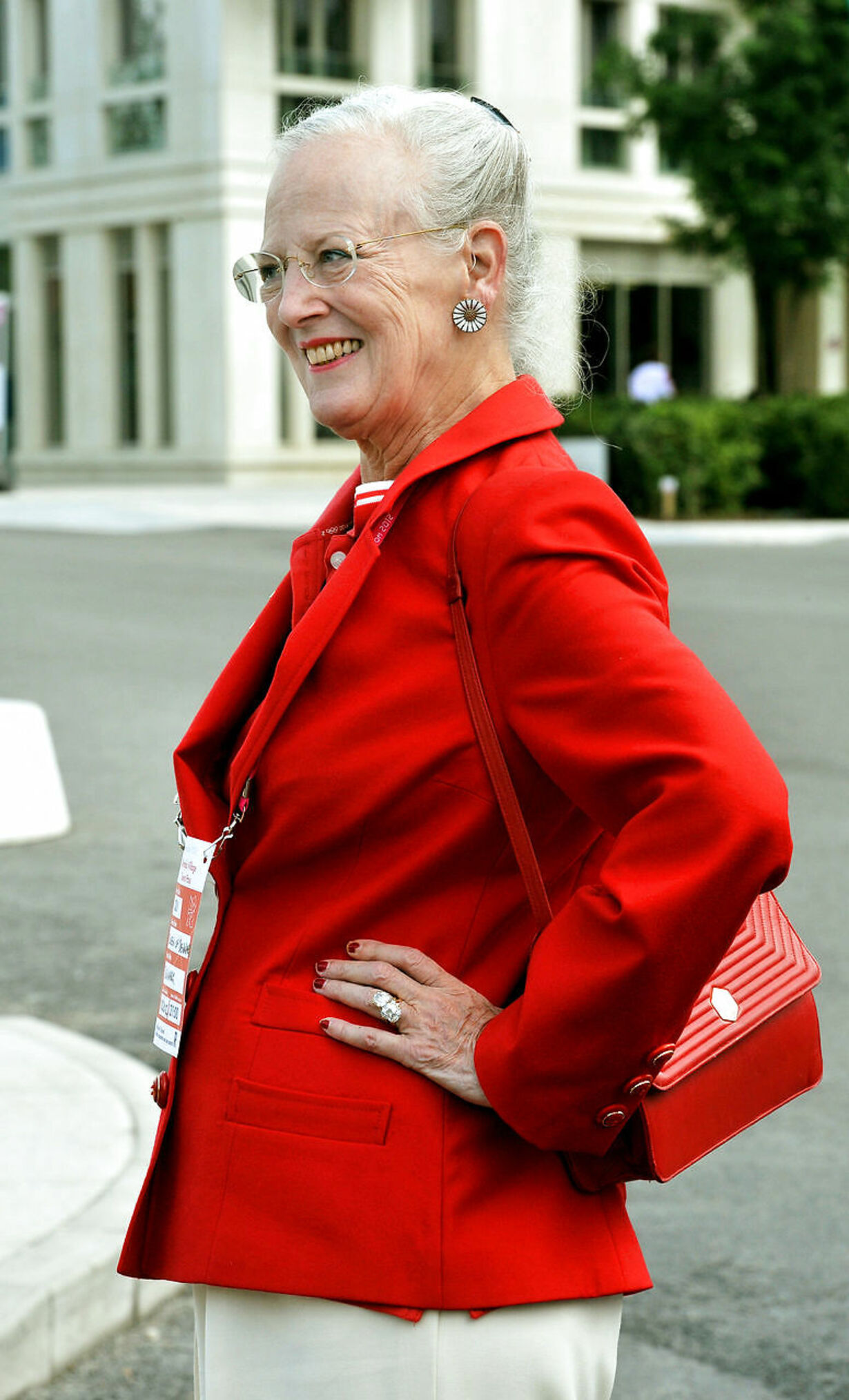 Queen Margrethe II of Denmark walks through the Olympic athletes