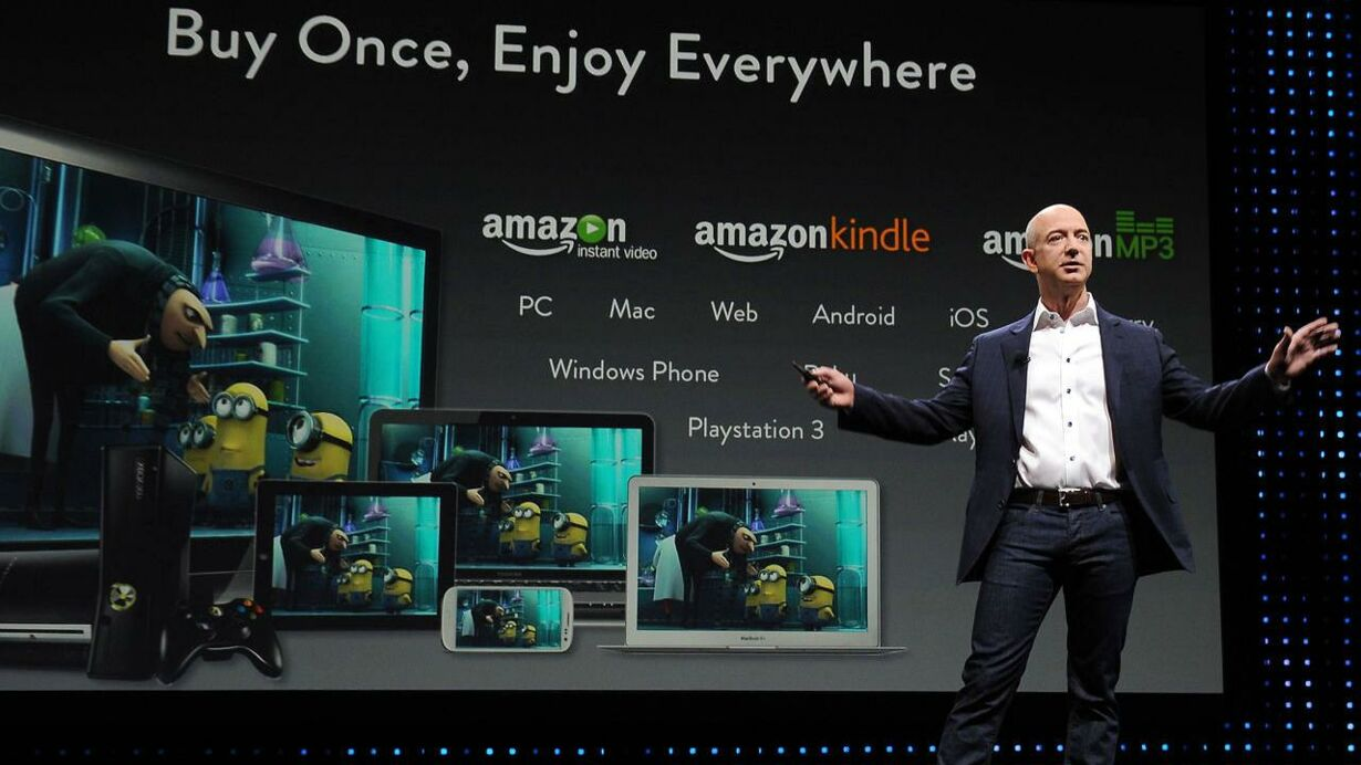 Jeff Bezos CEO of Amazon introduces new Kindle Paper white durin