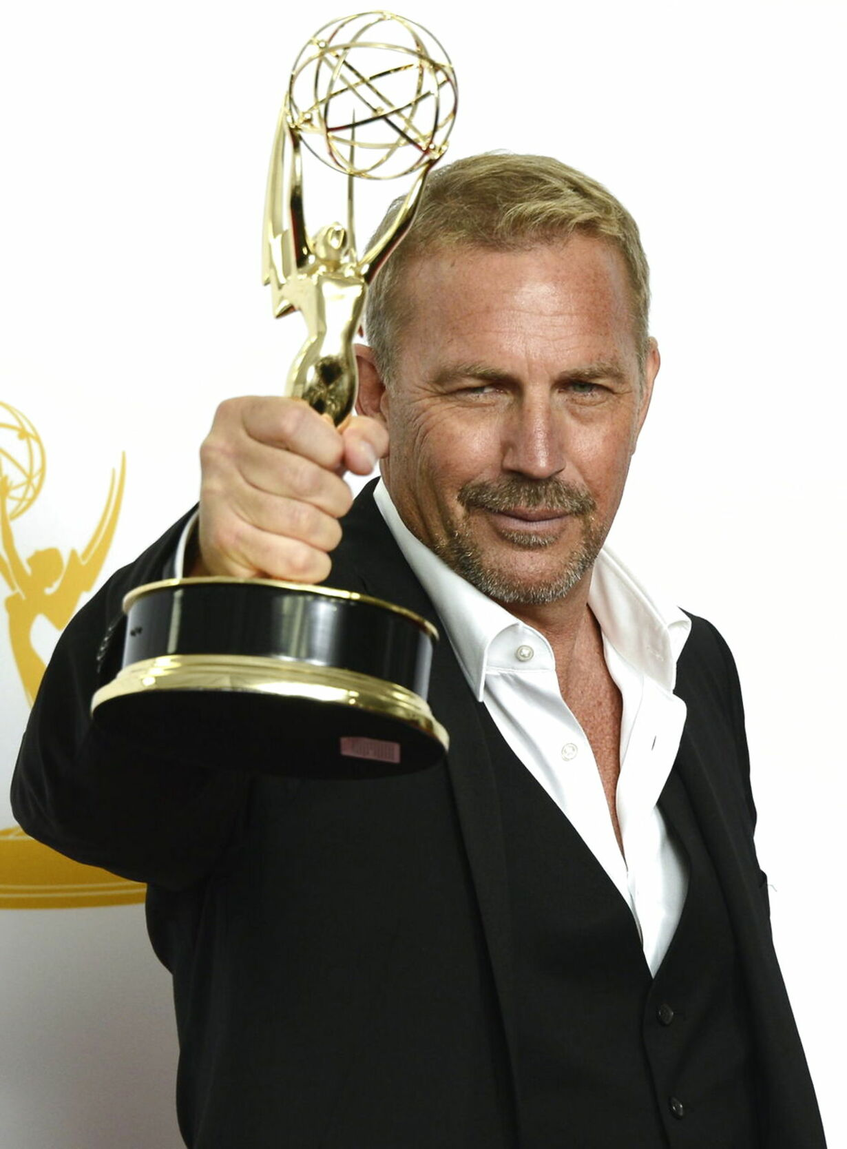 2012 epa03408510 US actor Kevin Costner holds the award for Outstandi
