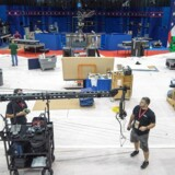 Sound technicians work on their boom mike as stage construction continues for the 2nd US Presidential debate, on October 7, 2016, at Washington University in St. Louis, Missouri. US Presidential Republican nominees Donald Trump and Democrat nominee Hillary Clinton will debate for the second time October 9, 2016. / AFP PHOTO / PAUL J. RICHARDS