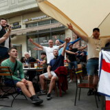 epa06878295 Soccer fans of England gather in Nikolskaya street near the Red Square in Moscow, Russia, 10 July 2018. England will face Croatia in their FIFA World Cup 2018 semi final soccer match on 11 July in Moscow EPA/MAXIM SHIPENKOV