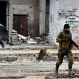 Syriske pro-regeringsstyrker i gang med en militæroperation i Aleppo 14. december.