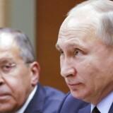 Den russiske præsident Putin (th) og udenrigsminister Sergej Lavrov
