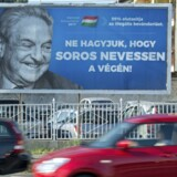 "A poster with US billionaire George Soros is pictured on July 6, 2017 in Szekesfehervar, Hungary. The head of Hungary's largest Jewish organisation says a ""poisonous"" poster campaign by the government that targets US billionaire George Soros is stoking anti-Semitic sentiments and urged its immediate scrapping. / AFP PHOTO / ATTILA KISBENEDEK / TO GO WITH AFP STORY"