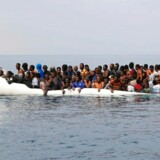 "(FILES) This file photo taken on March 20, 2017 shows migrants waiting to be rescued from a sinking dingey off the Libyan coasal town of Zawiyah, east of the capital, on March 20, 2017, as they attempted to cross from the Mediterranean to Europe. An Italian prosecutor claims on April 23, 2017 charity boats rescuing migrants in the Mediterranean are in direct contact with people traffickers in Libya, reigniting a bitter row over what the aid groups defend as vital, life-saving operations. In an interview with Italian daily La Stampa, Sicily-based prosecutor Carmelo Zuccaro made his most specific claims yet over NGO activities off Libya, which the EU border agency Frontex recently described as tantamout to providing a ""taxi"" service to Europe. / AFP PHOTO / Abdullah ELGAMOUDI"