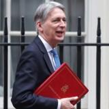 Den britiske finansminister, Philip Hammond, gør klar til at indføre særlig beskatning af teknologigiganterne, fordi han ikke kan vente på at få en international skatteaftale på plads. Arkivfoto: Daniel Leal-Olivas, AFP/Scanpix