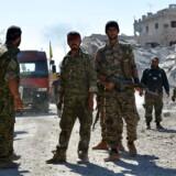 Styrker fra den Syriske Demokratiske Hær i det erobrede Raqqa.