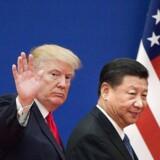Donald Trump og den kinesiske præsident Xi Jinping/ AFP PHOTO / Nicolas ASFOURI /