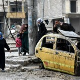 BMINTERN - Syrian civilians from the al-Sukari neighbourhood flee during the ongoing government forces military operation to retake remaining rebel-held areas in the northern embattled city of Aleppo on December 14, 2016. Shelling and air strikes sent terrified residents running through the streets of Aleppo as a deal to evacuate rebel districts of the city was in danger of falling apart. / AFP PHOTO / George OURFALIAN