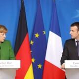 Tysklands kansler Angela Merkel og Frankrigs præsident Emmanuel Macron, 23. marts. (Foto: AFP PHOTO / Ludovic MARIN)