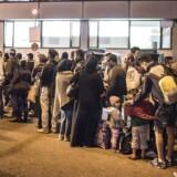 Arkivfoto: Flygtninge og migranter ankommer på banegården i München.