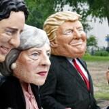 G7-topmøderne er en årlig tradition, men lige så traditionelt er efterhånden demonstrationerne i anledning af de store økonomiers sammenkomst. Her demonstranter med masker.