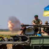 Ukrainske soldater under en øvelse nær Mariupol, Donetsk.