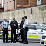 Politi ved Retten i Odense fredag d. 28 april 2017, hvor tre medlemmer af banden Black Army blev idømt fængsel i otte, syv og seks måneder for at afpresse tatovører i Odense.