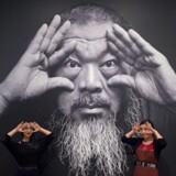 Two women touring Ai Weiwei's Trace at Hirshhorn exhibition pose for a photo on June 28, 2017 at the Hirshorn Museum in Washington, DC. / AFP PHOTO / PAUL J. RICHARDS / RESTRICTED TO EDITORIAL USE - MANDATORY MENTION OF THE ARTIST UPON PUBLICATION - TO ILLUSTRATE THE EVENT AS SPECIFIED IN THE CAPTION