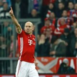 Bayern Munich's Dutch midfielder Arjen Robben celebrates scoring the opening goal during the UEFA Champions League round of sixteen football match between FC Bayern Munich and Arsenal in Munich, southern Germany, on February 15, 2017. / AFP PHOTO / Odd ANDERSEN
