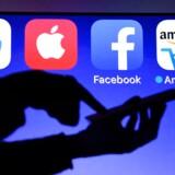 Briterne indfører fra 2020 digital skat for at tvinge Google, Amazon, Facebook, Apple m.fl. til at afregne skat for indtægter, der er hentet i landet, i stedet for at føre en del af dem videre til bl.a. Irland, hvor skatten er lavere. Arkivfoto: Damien Meyer/AFP/Ritzau Scanpiz