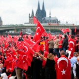 Supporters of Turkish President Recep Tayyip Erdogan attend a rally on July 31, 2016 in Cologne, as tensions over Turkey's failed coup put authorities on edge. Up to 30, 000 people are expected to answer a call to take to the streets issued by a pro-Erdogan group, the Union of European-Turkish Democrats (UETD), according to police. / AFP PHOTO / DPA / Oliver Berg / Germany OUT