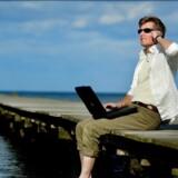 Alt for mange danskere tager deres arbejde med på ferie og får ikke stresset af. Scanpix/Bax Lindhardt/arkiv