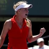 Caroline Wozniacki knytter næven efter et vinderslag mod Muguruza. Nu vil danskeren gå hele vejen i Miami.