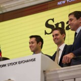 Snap Inc. co-founder Bobby Murphy(L) with CEO Evan Spiegel(C) and NYSE President Thomas Farley, ring the opening bell at the New York Stock Exchange on March 2, 2017 in New York. / AFP PHOTO / Bryan R. Smith