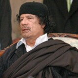 epa00891324 Libyan leader Muammar Gadaffi gestures as he talks about African affairs during the signing of a treaty of reconciliation between Chad and Libya in Tripoli on Sunday 24 December 2006. EPA/SABRI ELMHEDWI