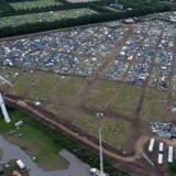 Lørdag åbner campingområdet til årets Roskilde Festival, hvor 130.000 gæster midlertidigt gør festivalen til Danmark fjerdestørste by. Onsdag åbner selve festivalpladsen, og det kan blive med temperaturer op til 30 grader. Vallekilde Højskole/Roskilde Festival/Ritzau Scanpix