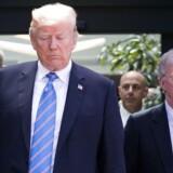 USAs præsident Donald Trump ses her med sin nationale sikkerhedsrådgiver, John Bolton (t.h.) og den nu afgåede stabschef John Kelly under sommerens G7-topmøde i La Malbaie, Quebec.