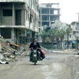 Ønsket er at kunne sende syrerne hjem, men den rå virkelighed er, at der er meget lidt at vende tilbage til. Foto: Maher Al Mounes/AFP/Ritzau Scanpix