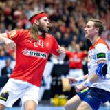 Mikkel Hansen of Denmark celebrates during the men's IHF Handball World Championship Group C match between Denmark and Norway in Herning, Denmark, Thursday, Jan. 17, 2019.