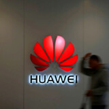 FILE PHOTO: A man walks by a Huawei logo at a shopping mall in Shanghai, China, Dec. 6, 2018. REUTERS/Aly Song/File Photo