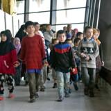 30 børn af mistænkte Islamisk Stat-jihadister på vej til at gå ombord på et russisk fly i lufthavnen i Bagdad 30. december 2018. Fædrene til børnene er enten dræbt eller arresteret.