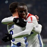 Lyon's French midfielder Houssem Aouar (L) celebrates after scoring a goal with Lyon's French defender Ferland Mendy (R) during the French L1 football match between Lyon (OL) and Monaco (ASM) on December 16, 2018, at the Groupama Stadium in Decines-Charpieu near Lyon, central-eastern France. ROMAIN LAFABREGUE / AFP