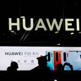 FILE PHOTO: A Huawei company logo is seen at CES (Consumer Electronics Show) Asia 2019 in Shanghai, China June 11, 2019. REUTERS/Aly Song/File Photo