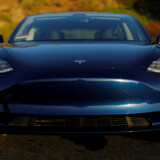 FILE PHOTO: A 2018 Tesla Model 3 electric vehicle is shown in this photo illustration taken in Cardiff, California, U.S., June 1, 2018. Picture taken June 1, 2018. REUTERS/Mike Blake/File Photo