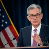"(FILES) In this file photo taken on June 19, 2019 Federal Reserve Board Chairman Jerome Powell speaks at a news conference after a Federal Open Market Committee meeting in Washington, DC. - Federal Reserve chief Jerome Powell's job at the head of the US central bank is safe, White House economic advisor Larry Kudlow said July 9, 2019.President Donald Trump has lambasted Powell repeatedly for raising interest rates, which he complains is undercutting his attempts to supercharge the US economy. Asked at an economic forum if Powell's job was said, Kudlow said, ""Yes, I believe it is. There is no effort to remove him - - I will say that unequivocally - - at the present time."" (Photo by NICHOLAS KAMM / AFP)"
