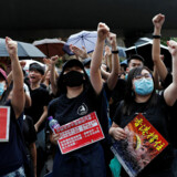 Anti-extradition bill protesters shout slogans to Chinese tourists during a march to West Kowloon Express Rail Link Station in Hong Kong, China July 7, 2019. Picture taken July 7, 2019. REUTERS/Tyrone Siu