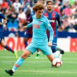 "(FILES) In this file photo taken on May 18, 2019 Atletico Madrid's French forward Antoine Griezmann controls the ball during the Spanish League football match between Levante and Atletico Madrid at the Ciutat de Valencia stadium in Valencia. - Atletico Madrid have accused Barcelona and Antoine Griezmann of a ""lack of respect"" after the Catalan giants' president Josep Maria Bartomeu revealed on July 5, 2019 that the two clubs had held talks about the signing of the France international. (Photo by JOSE JORDAN / AFP)"