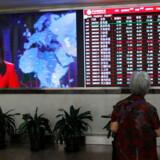 Kinesiske aktier gik i dørken, efter at Trump annoncerede straftold på flere kinesiske varer. Shanghai Composite lukkede fredag med at tab på 1,4 pct. Foto: EPA/Wu Hong/Ritzau Scanpix