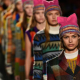 Models wearing pink hats walk the runway at the end of the show for fashion house Missoni during the Women's Fall/Winter 2017/2018 fashion week in Milan, on February 25, 2017. Italian designer Angela Missoni brought the political fight to Milan fashion week by ending her autumn-winter 2017 show with models clad in Pussyhats, the pink protest symbols of women's rights. Miguel MEDINA / AFP