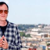 »Jeg laver ikke film, der bringer folk sammen. Jeg laver film, der vender folk mod hinanden,« sagde Quentin Tarantino, da harn modtog Guldpalmen for »Pulp Fiction«. Nu får han ballade igen – for »Once Upon a Time in... Hollywood«, der bliver lanceret i Europa i disse dage. Billedet er fra pressemødet i Rom tidligere på sommeren.