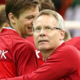 epa05505577 Coach Gudmundur Gudmunsson (R) and player Lasse Svan of the Gold medal team of Denmark reacr during the awarding ceremony of the men's Handball tournament for the Rio 2016 Olympic Games at the Future Arena in the Olympic Park in Rio de Janeiro, Brazil, 21 August 2016. EPA/SRDJAN SUKI