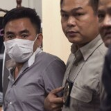 En af hovedmændene i et familiestyret kartel, der smuler elfenben, næsehornshorn og tigerdele i Asien, er blevet anholdt af politiet i Thailand.