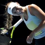Wozniacki skal tidligst skal i aktion klokken 19 lokal tid, hvilket svarer til klokken 9 om morgenen i Danmark. (AP Photo/Vincent Thian)
