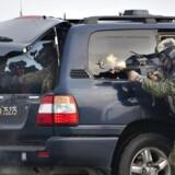 Tanken om at indsætte soldater i aktioner i danske gader, med tilhørende risiko for drab på civile, har traditionelt stået som et politisk skrækscenarie, men kan blive en del af fremtiden. Her er det Jægerkorpset som giver en af sine sjældne opvisninger af udstyr og mandskab på havnen i Aalborg i 2011.