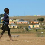 3/20 - PHOTO PACKAGE ON CHILDREN GOING TO SCHOOL - MORE AVAILABLE ON IMAGEFORUM: http://www.imageforum-diffusion. afp.com/ImfDiffusion/themes/ShowTheme. aspx?ThemeID=3103846&chgCtx=1&mui=1 A child walks to school on June 11, 2013 in Qunu, a village outside the town of Mthatha in the Eastern Cape, where former South African President Nelson Mandela grew up. Ordinarily Qunu is a slow-paced blend of livestock, locals on foot and the occasional car winding along the smattering of roads and dirt paths that link humble homesteads. But with Mandela again in hospital, his beloved village has become a magnet for the world's media, hoping to offer some insight into his life. AFP PHOTO / JENNIFER BRUCE RESTRICTED TO EDITORIAL USE