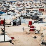 This picture shows a general view of the al-Hol camp in al-Hasakeh governorate in northeastern Syria, on August 08, 2019. - Months after the defeat of the jihadist proto-state, families of IS fighters are among 70, 000 people crammed into the Kurdish-run Al-Hol camp in northeastern Syria. (Photo by Delil SOULEIMAN / AFP)