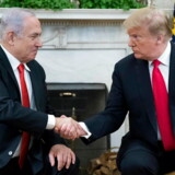 epa07884646 US President Donald J. Trump (R) and Prime Minister of Israel Benjamin Netanyahu (L) shake hands in the Oval Office of the White House in Washington, DC, USA, 25 March 2019. Trump earlier signed an order recognizing Golan Heights as Israeli territory. EPA/MICHAEL REYNOLDS