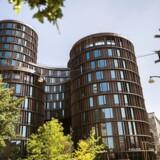 De fem cylindriske Axel Towers er både fremmede og nyskabende i bybilledet.